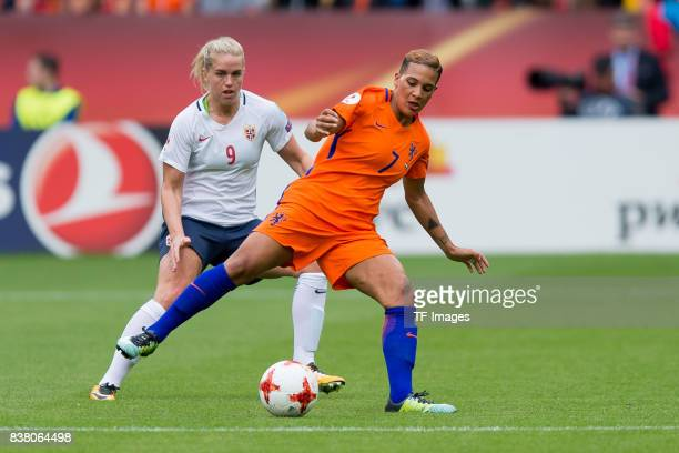 Elise Thorsnes of Norway and Shanice van de Sanden of the Netherlands battle for the ball during their Group A match between Netherlands and Norway...