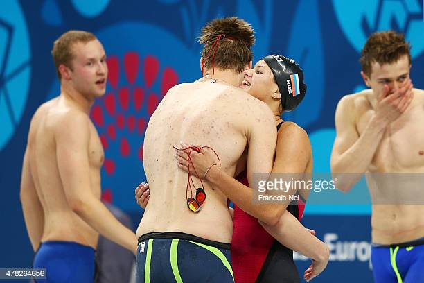 Elisei Stepanov and Mariia Kameneva of Russia celebrate winning gold in the Mixed 4x100m Freestyle Relay final during day twelve of the Baku 2015...