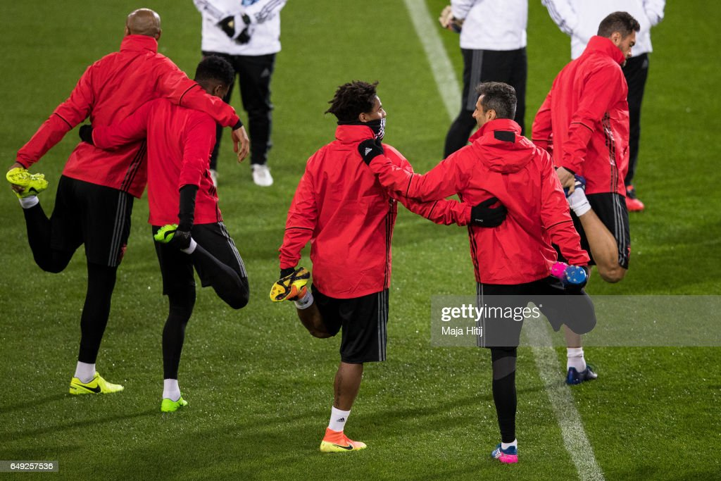 Eliseu (3L) and Jonas (2R) of Benfica warm up during the training prior the UEFA Champions League Round of 16 second leg match between Borussia Dortmund and SL Benfica at Signal Iduna Park on March 7, 2017 in Dortmund, Germany.