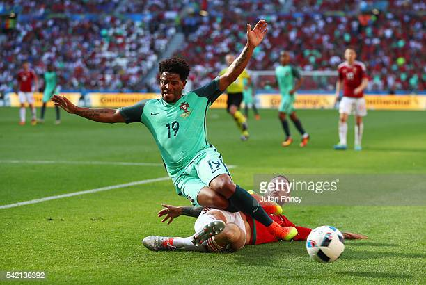 Eliseu of Portugal is tackled by Gergo Lovrencsics of Hungary during the UEFA EURO 2016 Group F match between Hungary and Portugal at Stade des...