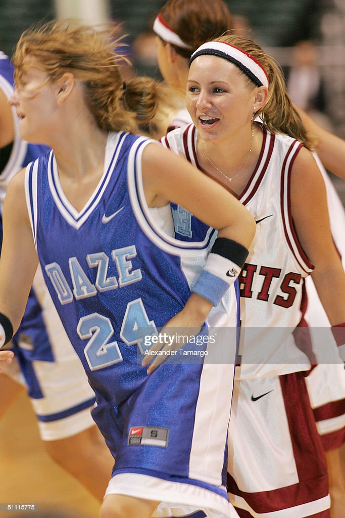 Elisha Cuthbert and Beverly Mitchell during the NSYNC Challenge For The Children Celebrity Basketball Game at Office Depot Center in Sunrise, Florida on July 25, 2004.