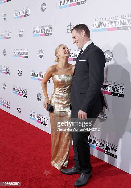 Elisha Cuthbert and Dion Phaneuf attends the 40th American Music Awards held at Nokia Theatre LA Live on November 18 2012 in Los Angeles California