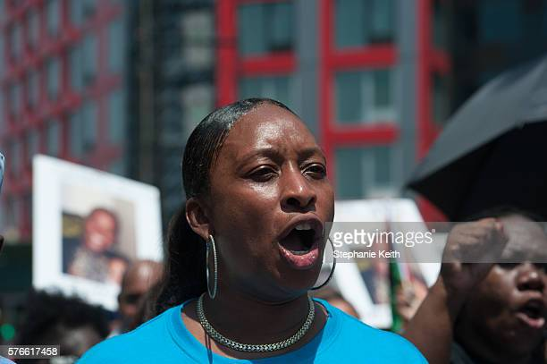 Elisha Flagg chants during a march commemorating the two year anniversary of Eric Garner's death on July 16 2016 in the Brooklyn borough of New York...