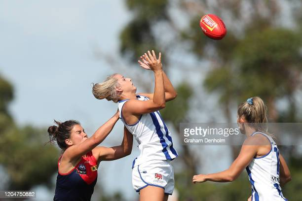 Elisha King of the Kangaroos leaps for the ball during the round one AFLW match between the Melbourne Demons and the North Melbourne Kangaroos at...