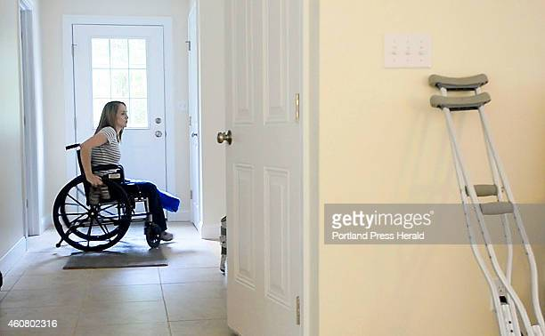 Elisha Morgan who has suffered for years with Chronic pain uses a wheelchair to move around her house Thursday June 26 2014