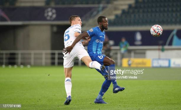Elisha Owusu of KAA Gent battles for the ball with Serhiy Sydorchuk of Kyiv during the UEFA Champions League PlayOff first leg match between KAA Gent...