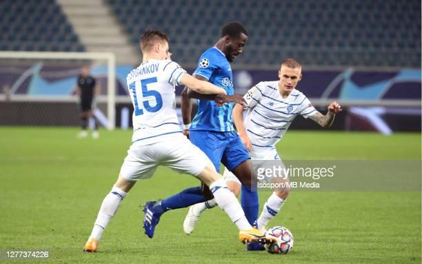 Elisha Owusu of KAA Gent battles for the ball with Viktor Tsygankov of Kyiv and Vitaliy Buyalskyi of Kyiv during the UEFA Champions League PlayOff...