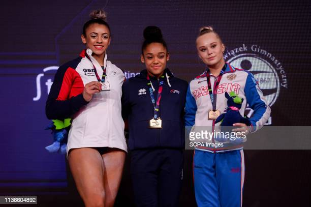 Elissa Downie from Great Britain Melanie De Jesus Dos Santos from France and Angelina Melnikova from Russia are seen posing with their medals during...