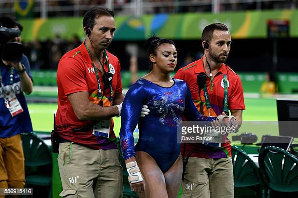 Elissa Downie of Great Britain walks off injured after falling on the floor routine during Women's qualification for Artistic Gymnastics on Day 2 of...