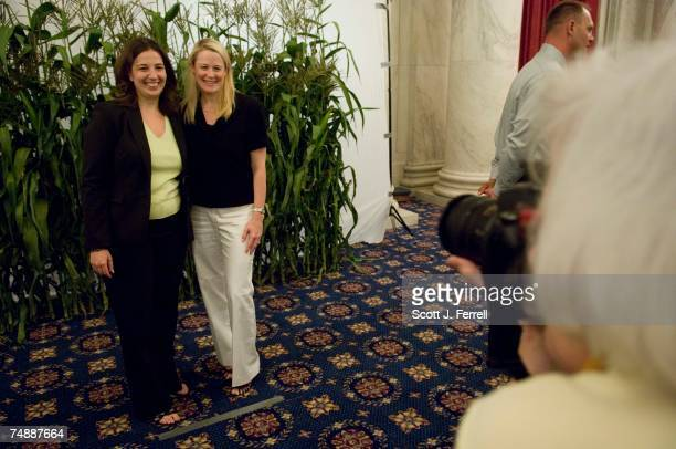 Elissa Levin an aide to Rep Tammy Baldwin DWis and Anne Steckel of the American Farm Bureau Federation have their photo taken in front of a corn...