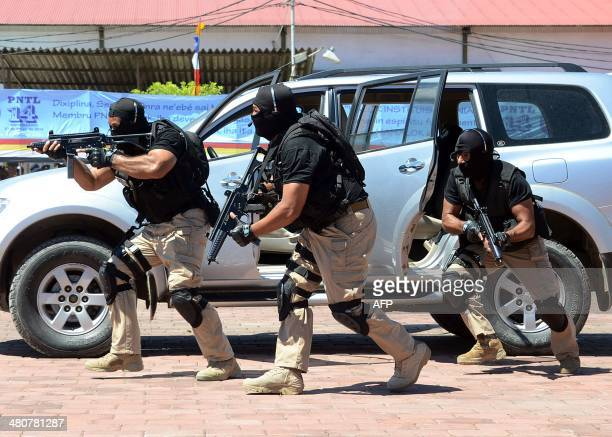 Elite East Timor police commandos demonstrate tactical skills in an antiterror demonstration during a celebration of the 14th anniversary of the...