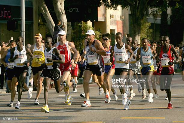 Elite male runners run together in a pack during mile one of the Los Angeles Marathon XX on March 6 2005 in Los Angeles California