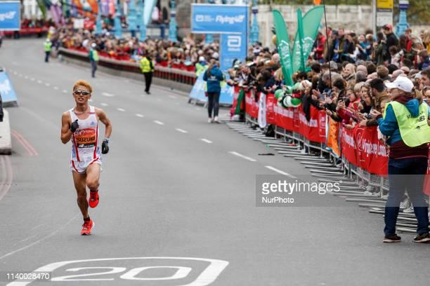 Elite men athletes cross Tower Bridge during the Virgin Money London Marathon in London England on April 28 2019
