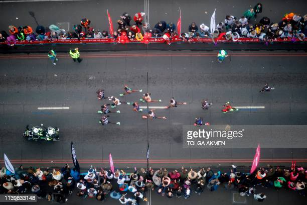 Elite men runners cross Tower Bridge as they approach halfway in the 2019 London Marathon in central London on April 28 2019 / Restricted to...