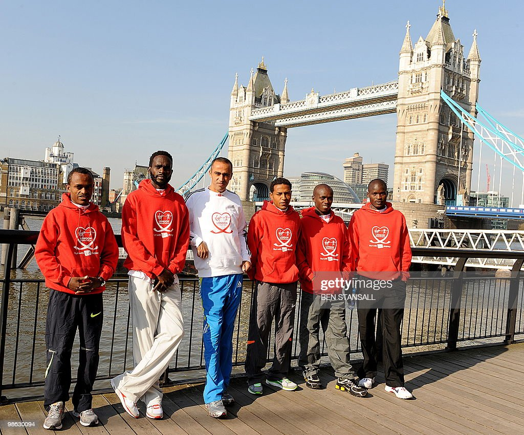 Elite Men's marathon runners (L-R) Ethiopia's Tsegaye Kebede, Kenya's Duncan Kibet, Morrocco's Jaouad Gharib, Eritrea's Zersen Tadesse, Kenya's Samuel Wanjiru and Kenya's Abel Kirui pose for photographers during a photocall in London, on April 23, 2010. The London Marathon will take place on Sunday April 25.