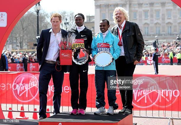 Elite Race winners Priscah Jeptoo of Kenya and Tsegaye Kebede of Ethiopia pose with Prince Harry and Sir Richard Branson following the Virgin London...
