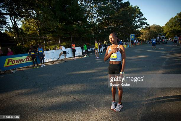 Elite runner and race champion Janet CherobonBawcom of Rome Ga paused during the National Anthem She just recently became a naturalized citizen The...