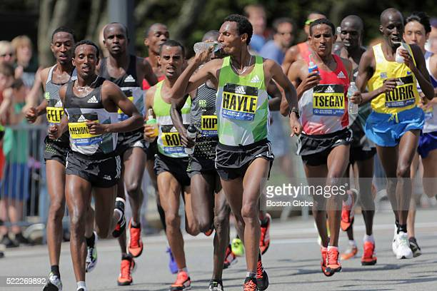 Elite runner Lemi Berhanu Hayle of Ethiopia who won the men's race drinks water before Mile 13 during the 120th Boston Marathon on Monday April 18...