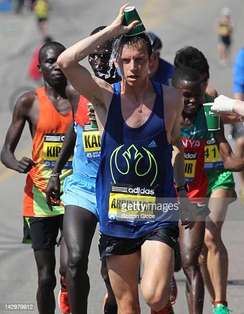 Elite runner Nicholas Arciniaga USA cools off on the course during the Boston Marathon