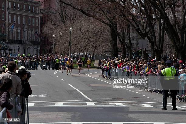 CONTENT] Elite runners approaching the end of the Boston Marathon before the blast occurred