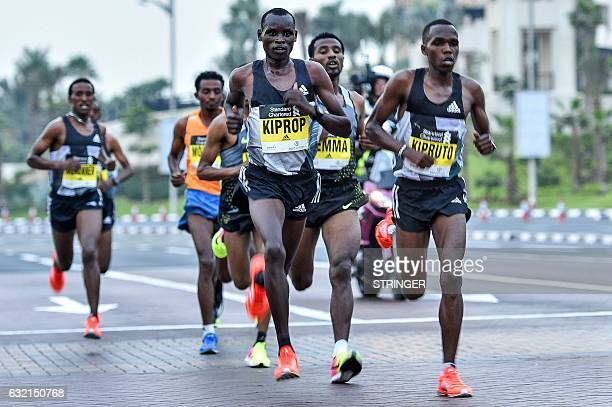 Elite runners compete in the Dubai Marathon in the Gulf emirate on January 20 2017 Middle distance legend Kenenisa Bekele who was aiming to add the...