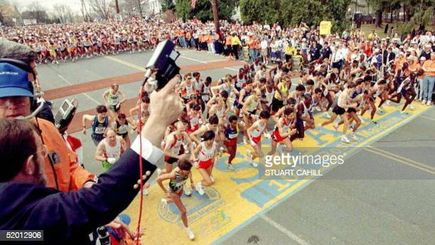 Elite runners of the 101st Boston Marathon cross the starting line as the offical gun is fired at 12 noon in Hopkinton, MA, 21 April. This year's...