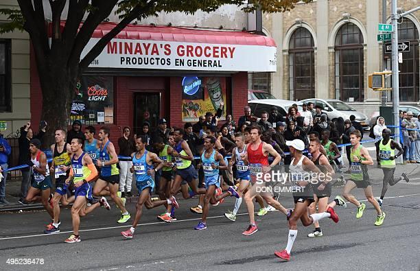 Elite runners run through the streets of Brooklyn during TCS New York City Marathon in New York November 1 2015 AFP PHOTO / DON EMMERT