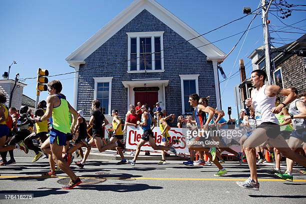 Elite runners take off from the starting line of the 41st Falmouth Road Race in Woods Hole, Mass., Aug. 11, 2013.