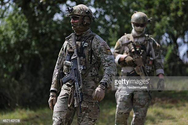 KSK elite soldiers are seen during German Defense Minister Ursula von der Leyen visits the troops of the elite KSK unit demonstrate their skills at a...