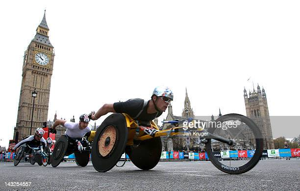Elite wheelchair athletes makes their way past Westminster during the Virgin London Marathon 2012 on April 22 2012 in London England