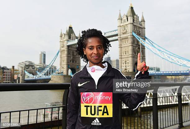 Elite women 2015 race winner Tigist Tufa of Ethiopia poses in front of Tower Bridge as they attend a photocall ahead of the Virgin Money London...