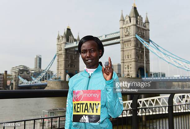 Elite women competitor Mary Keitany of Kenya poses in front of Tower Bridge as she attends a photocall ahead of the Virgin Money London Marathon at...