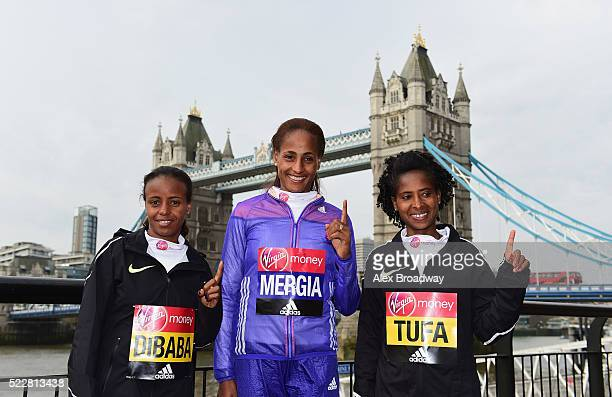 Elite women competitors Mare Dibaba, Aselefech Mergia and Tigist Tufa of Ethiopia pose in front of Tower Bridge as they attend a photocall ahead of...
