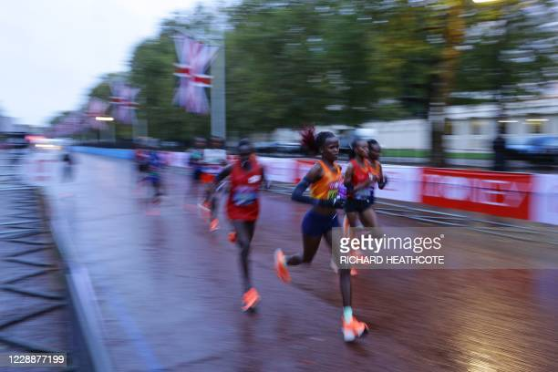 Elite women's pacemakers and leaders on the Mall at the end of the first lap in the women's race of the 2020 London Marathon in central London on...