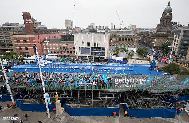 Elite Women's Race competitors pass thousands of fans that have lined the Leeds City Centre Streets on June 12 2016 in Leeds England