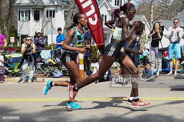 Elite women's runners make their way along Commonwealth Avenue near 'Heartbreak Hill' in Newton Mass during the 120th Boston Marathon on April 18 2016