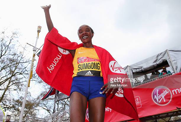 Elite womens winner Jemima Sumgong of Kenya celebrates after the Virgin Money Giving London Marathon at the finish on The Mall on April 24 2016 in...