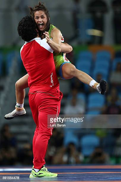 Elitsa Atanasova Yankova of Bulgaria celebrates winning bronze against Patricia Alejandra Bermudez of Argentina in the Women's Freestyle 48kg event...