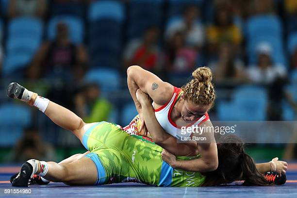 Elitsa Atanasova Yankova of Bulgaria competes against Patricia Alejandra Bermudez of Argentina during a Women's Freestyle 48kg Bronze Medal bout on...