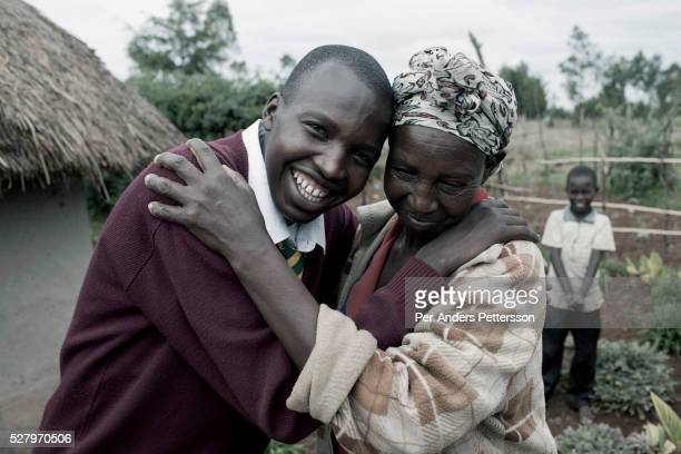 Eliud Kibet age 18 with his mother in his home village outside Eldoret Kenya He is a promising long distance runner and attends the boarding school...