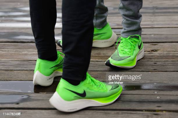 Eliud Kipchoge and Sir Mo Farah attend the Elite men's photocall ahead of Sunday's London Marathon at The Tower Hotel on April 24 2019 in London...