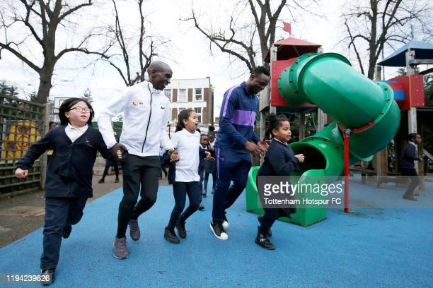 Eliud Kipchoge and Victor Wanyama run alongside students at Earlsmead Primary School to show support for the London Marathon Daily Mile Initiative on...