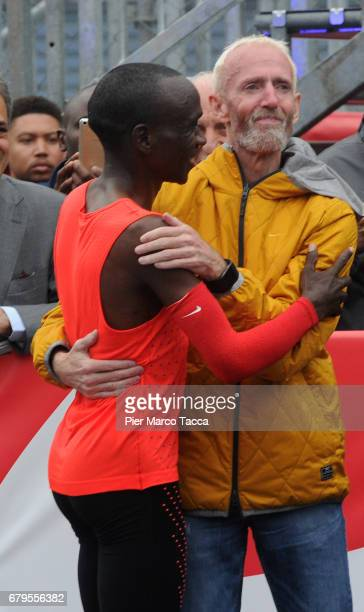 Eliud Kipchoge embraces with Sandy Bodecker VP action Sport at Nike at the finish area during the Nike Breaking2 SubTwo Marathon Attempt at Autodromo...
