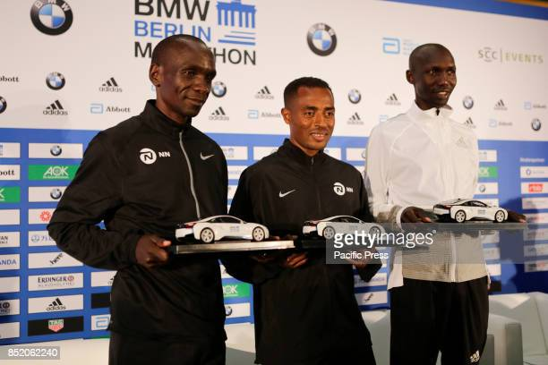 Eliud Kipchoge Kenenisa Bekele and Wilson Kipsang pose for the cameras from left to right at the press conference The three leading runners competing...
