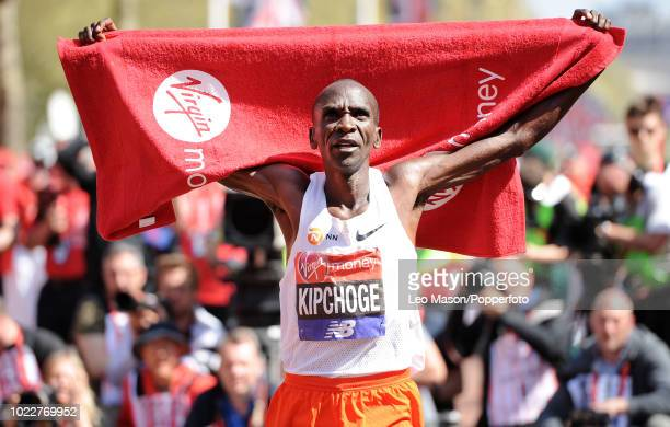 Eliud Kipchoge of Kenya celebrates after the Elite mens race during the Virgin London Marathon on April 22 2018 in London Kipchoge won in a time of...