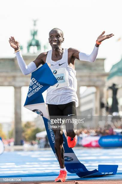 Eliud Kipchoge of Kenya celebrates after winning the Berlin Marathon 2018 in a new world record time of 20139 on September 16 2018 in Berlin Germany