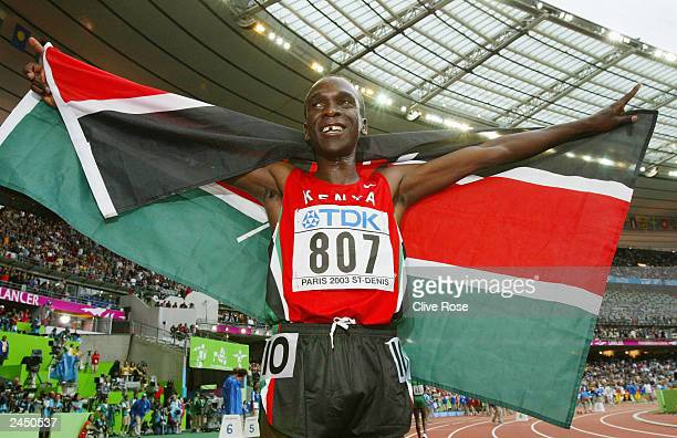 Eliud Kipchoge of Kenya celebrates after winning the gold medal in the men's 5000m final at the 9th IAAF World Athletics Championship at the Stade de...