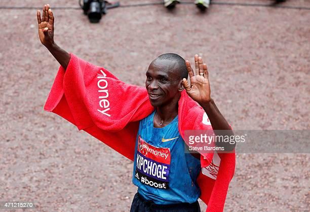 Eliud Kipchoge of Kenya celebrates after winning the Men's race during the Virgin Money London Marathon on April 26 2015 in London England