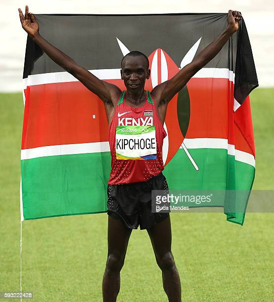 Eliud Kipchoge of Kenya celebrates as he wins gold during the Men's Marathon on Day 16 of the Rio 2016 Olympic Games at Sambodromo on August 21 2016...
