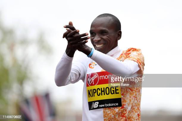 Eliud Kipchoge of Kenya celebrates during the victory ceremony after wins the Men's Elite race during the Virgin Money London Marathon at United...